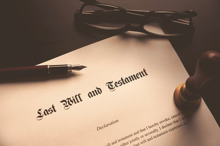 Last Will and Testament document with pen and glasses